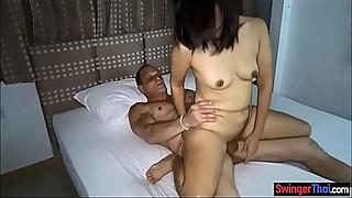Thai amateur wife cuckolds her husband with his friend