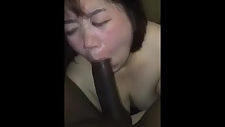Asian fat whore of a woman with a big black cock